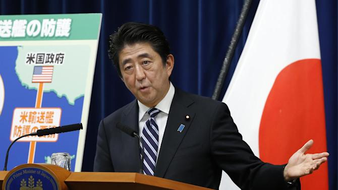 Japan's Prime Minister Shinzo Abe speaks during a press conference at the prime minister's official residence in Tokyo, Thursday, May 15, 2014. Citing threats from China and North Korea, a government-appointed panel is urging Japan to reinterpret its pacifist constitution to allow the use of military force to defend other countries. The recommendation, submitted Thursday to Prime Minister Abe, sets the stage for his push to allow the military to play a greater role in international security. (AP Photo/Shizuo Kambayashi)
