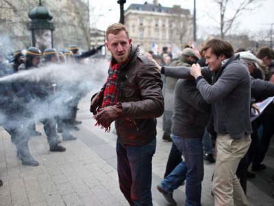Raw: Tear Gas Used Against Protesters in France