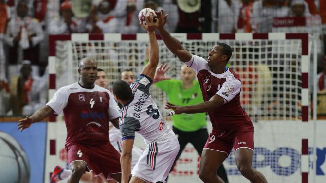 Mabrouk and Capote of Qatar block Narcisse of France during their final match of the 24th Men's Handball World Championship in Doha