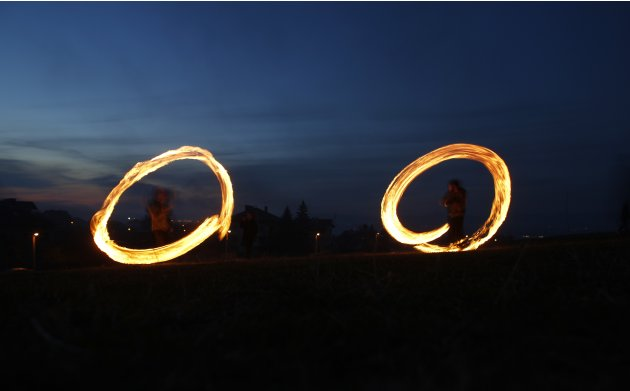 Children spin rings of fire during rituals in celebration of Sirni Zagovezni, the first Sunday before Great Lent, in the village of Lozen