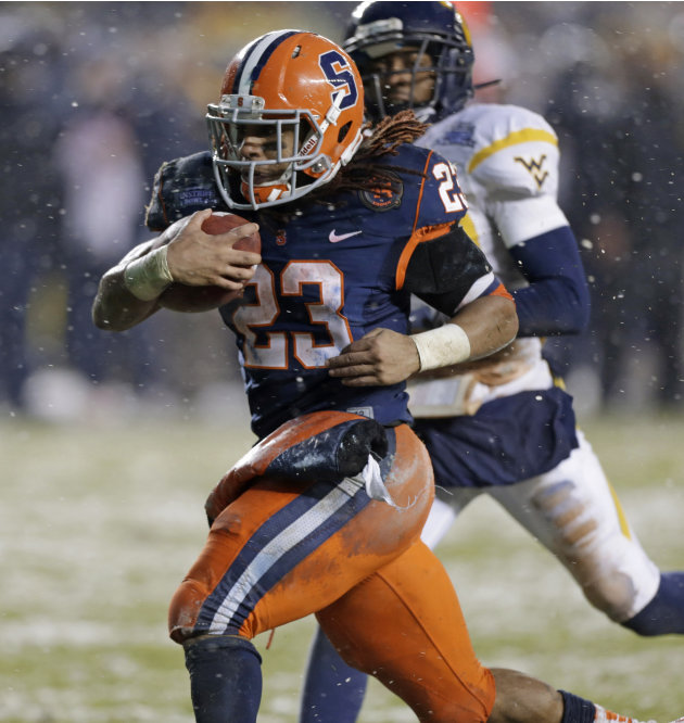 With West Virginia cornerback Pat Miller, rear, in pursuit, Syracuse running back Prince-Tyson Gulley (23) heads for the end zone for a second-quarter touchdown in the Pinstripe Bowl NCAA college foot