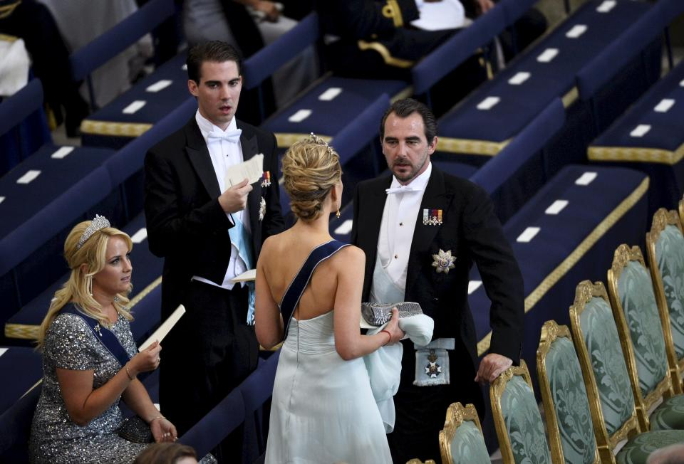 Prince Nikolaos of Greece and his wife Tatiana take their seats in the Royal Chapel before the wedding of Sweden's Princess Madeleine and Christopher O'Neill, in Stockholm Saturday June 8, 2013 at the Royal Chapel of the palace. (AP Photo/Anders Wiklund) ** SWEDEN OUT **