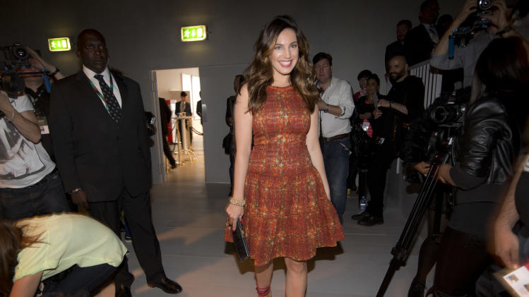 Model Kelly Brook arrives to watch the Bora Aksu Spring/Summer 2013 collection show during London Fashion Week, Friday, Sept. 14, 2012.  (AP Photo/Joel Ryan)