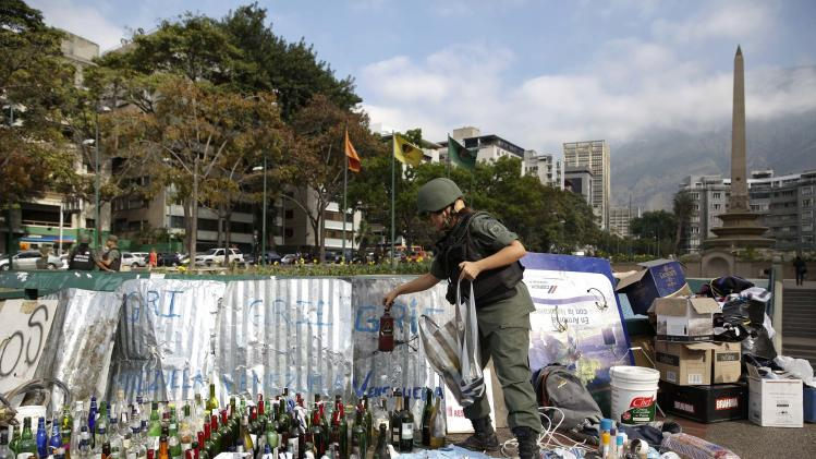 A national guard holds a bottle of molotov cocktail at Altamira square in Caracas