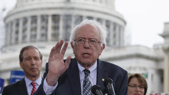 Sen. Bernie Sanders, I-Vt., center, joined by Sen. Tom Udall, D-N.M., left, and Sen. Amy Klobuchar, D-Minn., right, speaks at a news conference on Capitol Hill in Washington, Monday, Sept. 8, 2014, calling for an amendment to the Constitution aimed at curbing special interests' financial clout in elections. Members of the Senate and the House of Representatives returned to Capitol Hill today after a five-week vacation. (AP Photo/J. Scott Applewhite)