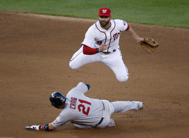 Nationals second baseman Danny Espinosa tries for a double play as St. Louis Cardinals' Craig slides safely into second base during the sixth inning in Game 4 of their MLB NLDS baseball series in Wash