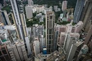 High rise buildings in Hong Kong in August 2012. Hong Kong announced the first step in a policy aimed to restrict foreigners from buying property, in a move seen to be targeting mainland buyers who have been blamed for pushing up property prices