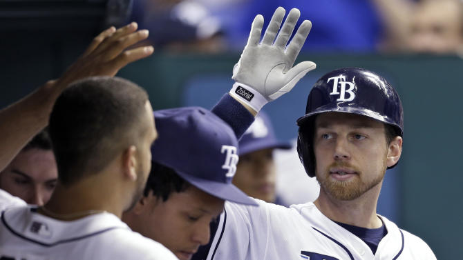 Tampa Bay Rays' Ben Zobrist, right, high-fives teammates in the dugout after his fourth-inning home run off Detroit Tigers starting pitcher Max Scherzer during a baseball game, Friday, June 28, 2013, in St. Petersburg, Fla. (AP Photo/Chris O'Meara)