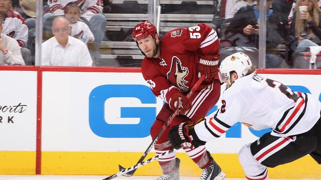 Derek Morris #53 Of The Phoenix Coyotes Centers The Puck Past Duncan Keith #2 Of The Chicago Blackhawks In The Second Getty Images