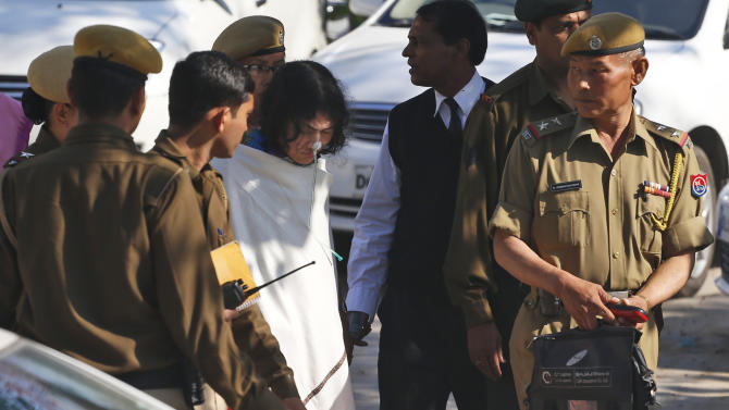Irom Sharmila, center, who has been on a decade-long hunger strike protesting an anti-terror law is escorted by police for an appearance at Patiala House court in New Delhi, India, Monday, March 4, 2013. The 40-year-old woman, who has spent the past 12 years without voluntarily taking food or water, was charged with attempted suicide by a court on Monday for protesting in the Indian capital in 2006 demanding withdrawal of an anti-terror law that grants Indian soldiers sweeping powers to crack down on rebels. Sharmila had her last voluntary meal on Nov. 4, 2000, in Imphal, capital of Manipur, one of several northeastern states facing armed rebellions against Indian rule. She was arrested three days later and has been force-fed through her nose ever since in a hospital. (AP Photo/Saurabh Das)
