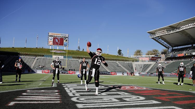National team quarterback Jeffrey Tuel (12) of Washington State warms up before the NFLPA Collegiate Bowl on Saturday, Jan. 19, 2013 in Carson, Calif. (Ric Tapia/AP Images for NFLPA)