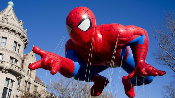 FILE - This Nov. 24, 2011 file photo shows the Spider-Man balloon during the Macy's Thanksgiving Day Parade in New York. The parade has to be a crowd-pleaser for a multigenerational crowd. More than 3 million people typically attend the event that also unfolds in front of a TV audience of 50 million. This year's parade will feature balloons include Papa Smurf and the Elf on a Shelf, while Buzz Lightyear, Sailor Mickey Mouse and the Pillsbury Doughboy keep their place in the lineup. A new version of Hello Kitty is also to be included. (AP Photo/Charles Sykes, file)