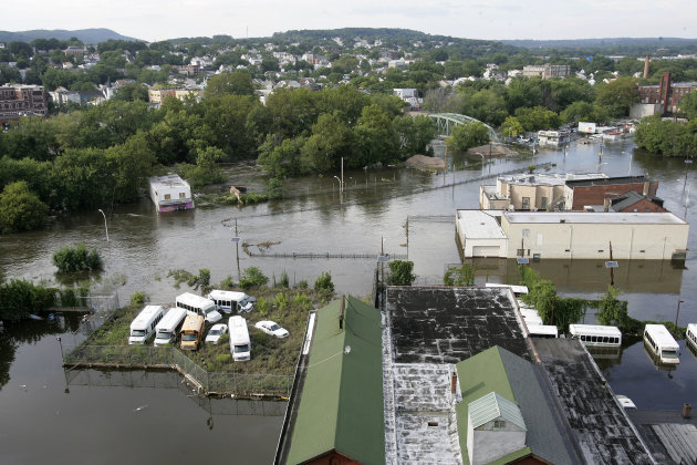 The swollen Passaic River floods River Road in Paterson, N.J., Wednesday, Aug. 31, 2011. Three days after Hurricane Irene blasted through the state and up the East Coast, there was little respite for