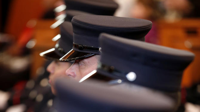 Firefighter cadets sit together during a swearing in ceremony into the Newark Fire Department, Tuesday, Oct. 9, 2012, in Newark, N.J. Twenty-eight of the 31 cadets served in the U.S. military fighting in Afghanistan or Iraq. The veterans were recruited through the GI Go Fund, a nonprofit New Jersey-based organization that helps provide assistance for veterans. The group worked with Mayor Cory Booker to open a Veterans Center in Newark City Hall. (AP Photo/Julio Cortez)