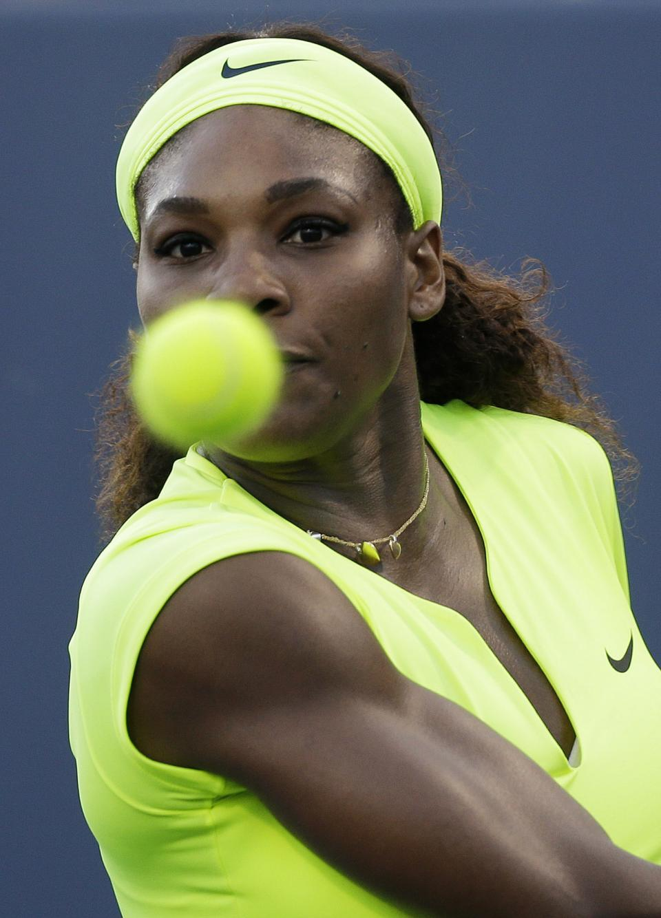 Serena Williams, of the United States, returns to Chanelle Scheepers, of South Africa, during a quarterfinal of the Bank of the West tennis tournament on Friday, July 13, 2012, in Stanford, Calif. (AP Photo/Marcio Jose Sanchez)