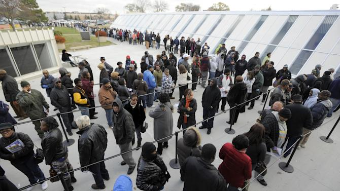 Voters wait in line to receive absentee ballots at the Wayne County Community College Northwest Campus in Detroit, Monday, Nov. 5, 2012. Voters flocked to local clerks offices Monday for the final day of absentee balloting with a three-to-five-hour wait in Detroit as thousands flocked to cast ballots. (AP Photo/Detroit News, David Guralnick)