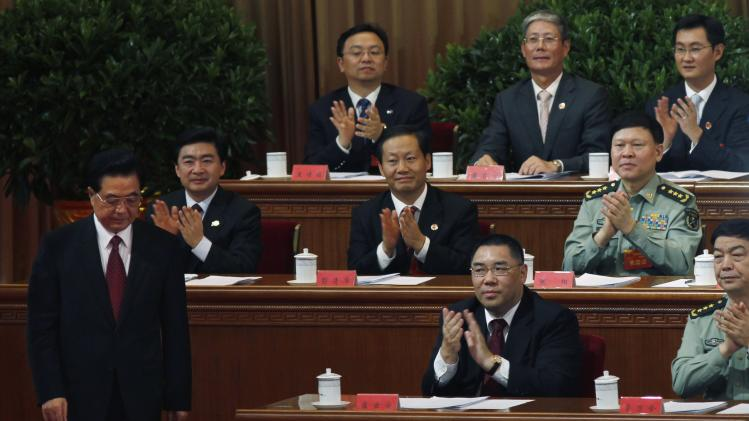 File photo of Macau's Chief Executive applauding as China's then President Hu prepares to give an address during a ceremony in Shenzhen