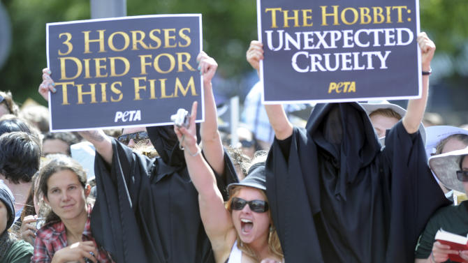 "Protesters against the death of animals during the filming of ""The Hobbit: An Unexpected Journey"" display banners on the red carpet for the premiere of the movie in Wellington, New Zealand, Wednesday, Nov. 28, 2012. (AP Photo/SNPA, Ross Setford) NEW ZEALAND OUT"