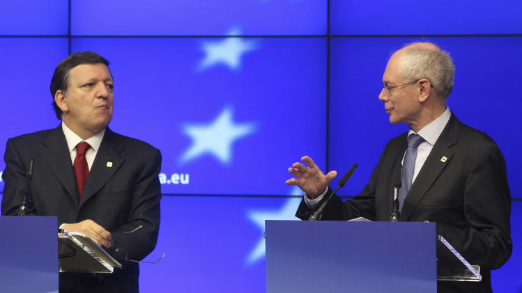 European Council President Herman Van Rompuy, right, and European Commission President Jose Manuel Barroso, address the media at the end of an EU summit, at the European Council building in Brussels, Thursday, May 24, 2012. The leaders of the 27 countries that make up the European Union met in Brussels to try and find a way to keep the debt crisis in Europe from spiraling out of control and promote jobs and growth. Rompuy said that all EU leaders want Greece to remain in the eurozone while respecting its commitments to pay back its debt. (AP Photo/Yves Logghe)