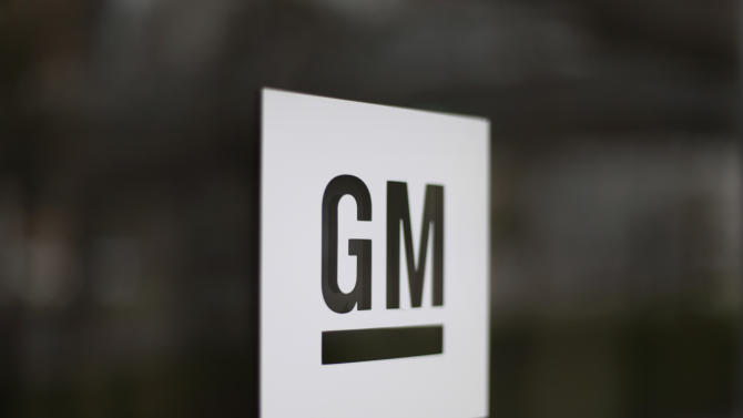 FILE - This Friday, May 16 2014 file photo shows the General Motors logo at the company's world headquarters in Detroit. General Motors plans to release the results of an outside attorney's investigation into its mishandled recall of small cars on Thursday morning, June 5, 2014. (AP Photo/Paul Sancya, File)