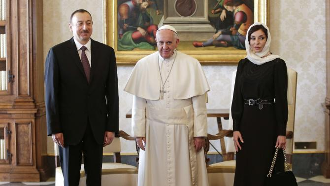 Pope Francis poses with President of Azerbaijan Aliyev and his wife Aliyeva during a meeting at the Vatican