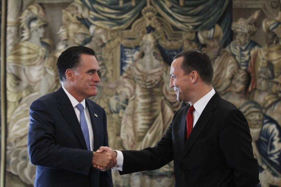 Republican presidential candidate and former Massachusetts Gov. Mitt Romney meets with Poland's Foreign Minister Radoslaw Sikorski in Warsaw, Poland, Tuesday, July 31, 2012. (AP Photo/Charles Dharapak)
