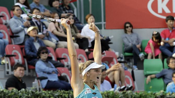 Karolina Pliskova of the Czech Republic celebrates after winning her final match against Varvara Lepchenko of the United States at the Korea Open tennis championships in Seoul, South Korea, Sunday, Sept. 21, 2014. Pliskova won the match 6-3, 6-7, 6-2. (AP Photo/Ahn Young-joon)