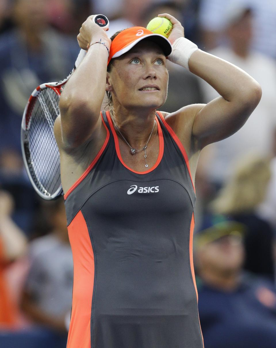 Samantha Stosur, of Australia, reacts after winning her match Britain's Laura Robson in the fourth round of play at the 2012 US Open tennis tournament,  Sunday, Sept. 2, 2012, in New York. (AP Photo/Kathy Willens)