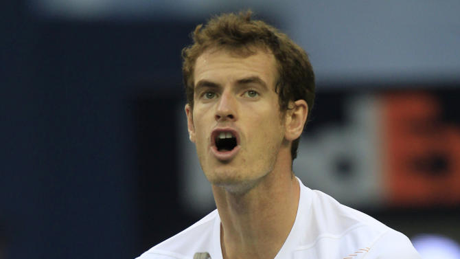 Andy Murray of Britain reacts after missing a return shot against Radek Stepanek of the Czech Republic in their men's singles quarterfinal match at the Shanghai Masters tennis tournament at Qizhong Forest Sports City Tennis Center in Shanghai, China, Friday Oct. 12, 2012. (AP Photo/Eugene Hoshiko)