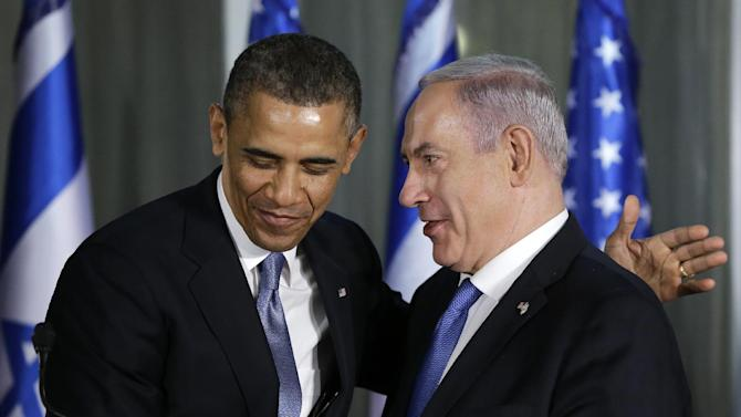 President Barack Obama and Israeli Prime Minister Benjamin Netanyahu come together on stage after a joint news conference, Wednesday, March 20, 2013, at the prime minister's residence in Jerusalem. (AP Photo/Carolyn Kaster)