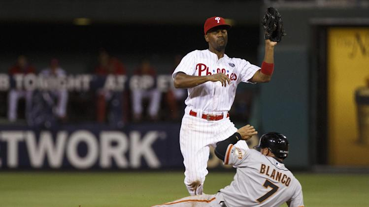 San Francisco Giants' Gregor Blanco, bottom, steals second before Philadelphia Phillies shortstop Jimmy Rollins, top, got get the ball during the ninth inning of a baseball game, Wednesday, July 23, 2014, in Philadelphia. The Giants won 3-1. (AP Photo/Chris Szagola)
