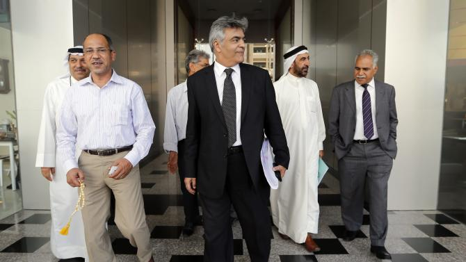 Lawyers representing two of Bahrain's main opposition parties Al-Wefaq National Islamic Society and the National Democratic Action Society, known as Waad, leave court after a hearing in Manama