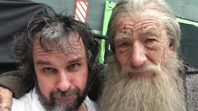 """This Friday, July 26, 2013 photo taken and released by Peter Jackson, actor Ian Murray McKellen, right, as Gandalf poses with Jackson on the final day of filming of The Hobbit in Wellington, New Zealand. Jackson has wrapped up filming """"The Hobbit"""" trilogy and shared pictures of his last day on the set with his Facebook fans. The New Zealand filmmaker provided a steady stream of updates and photos from the set of the final film, """"The Hobbit: There And Back Again,"""" on Friday, July 26. The second film, """"The Hobbit: The Desolation of Smaug,"""" will be released in December, and the finale appears in 2014. (AP Photo/Peter Jackson) MANDATORY CREDIT(AP Photo/Peter Jackson)"""