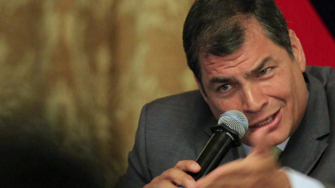 FILE - In this Aug. 22, 2012 file photo, Ecuador's President Rafael Correa speaks at a meeting with foreign correspondents in Quito, Ecuador. Correa has long used his bully pulpit to bash bankers as profit-mongers who brought Ecuador and the rest of the world to the edge of financial collapse. Now, he says he'll give a bigger share of those profits to the country's poor. (AP Photo/Dolores Ochoa, File)
