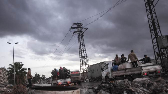 Syrians stand on trucks at a street in Aleppo, Syria, Tuesday, Dec. 4, 2012. Temperatures dropped to 16 degrees Celsius (60.8 Fahrenheit) in Aleppo. (AP Photo/Narciso Contreras)