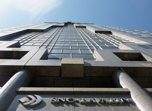 <p>SNC-Lavalin's headquarters in Montreal, Quebec. Swiss authorities have charged a former SNC-Lavalin executive with money laundering over mysterious payments by the Canadian engineering firm, Canada's and Switzerland's public broadcasters said Sunday.</p>
