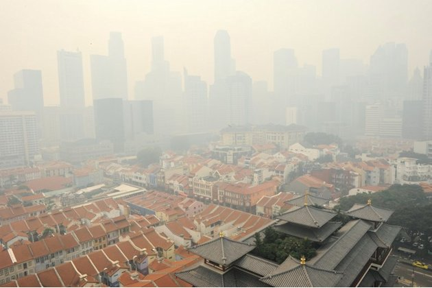 A general view shows part of Singapore, shrouded by haze, on June 20, 2013