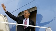 President Barack Obama waves as he boards Air Force One before his departure from Andrews Air Force Base, Md., Wednesday, Sept., 5, 2012. Obama is traveling to Charlotte, NC., for the Democratic National Convention.(AP Photo/Pablo Martinez Monsivais)