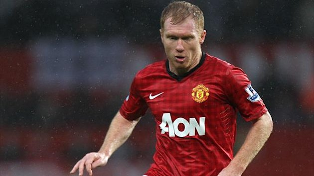 Paul Scholes in action for Manchester United (PA Photos)