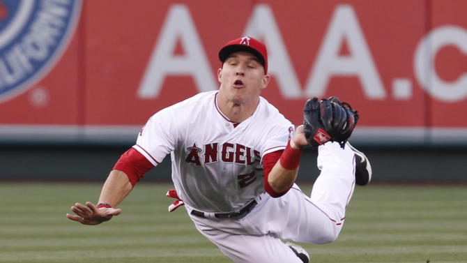 Los Angeles Angels center fielder Mike Trout makes a diving catch off a fly ball hit by Toronto Blue Jays catcher J.P. Arencibia in the third inning of a baseball game in Anaheim, Calif.,  on Saturday May 5, 2012. (AP Photo/Christine Cotter)