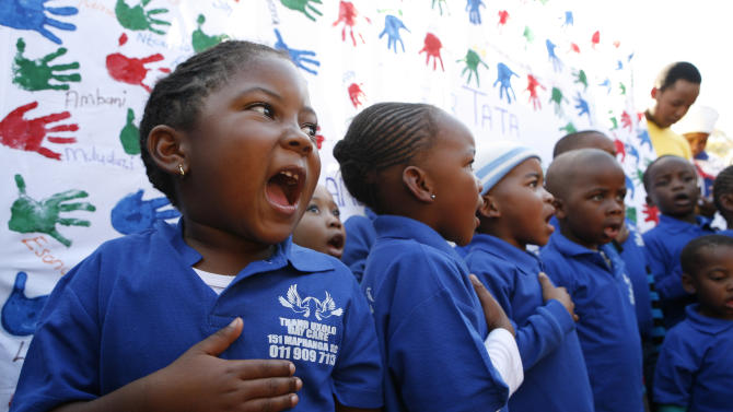 Children from Thanduxolo day care sing outside the Mediclinic Heart Hospital where former South African President Nelson Mandela is being treated in Pretoria, South Africa Wednesday, June 26, 2013. South Africa's president Jacob Zuma on Tuesday urged his compatriots to show their appreciation for Nelson Mandela, who is in critical condition in a hospital, by marking his 95th birthday next month with acts of goodness that honor the legacy of the anti-apartheid leader. (AP Photo/Themba Hadebe)