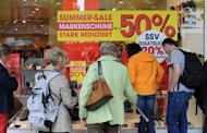 <p>German customers crowd in front of a shop offering its summer sales in Berlin. Chancellor Angela Merkel has warned the eurozone should not rush headlong into a banking union, amid signs Germany is being sucked into the abyss and fresh worries over Greece and Spain.</p>