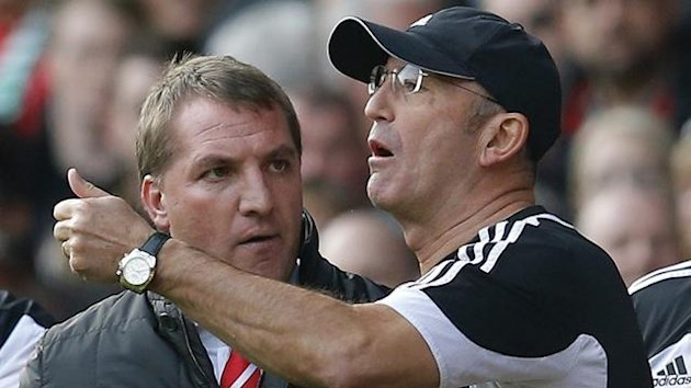 Liverpool's manager Brendan Rodgers argues with his Stoke City counterpart Tony Pulis