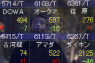 <p>               A man looks at an electronic stock board of a securities firm in central Tokyo, Japan, Friday,  Feb. 10, 2012. Asian stock markets dropped Friday after Europe's finance ministers demanded more spending cuts from Greece before clearing a €130 billion ($170 billion) bailout to stave off the country's bankruptcy. (AP Photo/Itsuo Inouye)