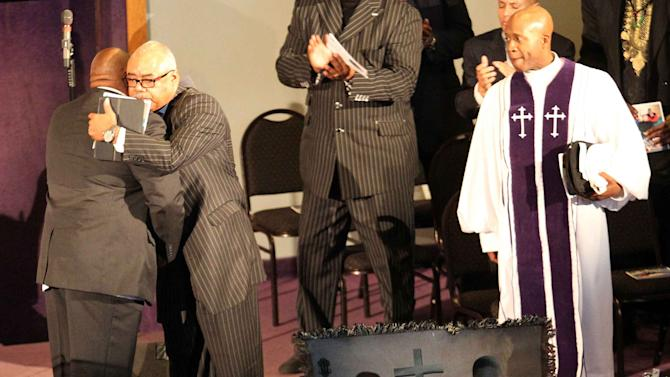 Uncle of Tamir Rice, Michael Petty, embraces pastor Jay Matthews during the funeral of Rice in Cleveland, Ohio in this file photo