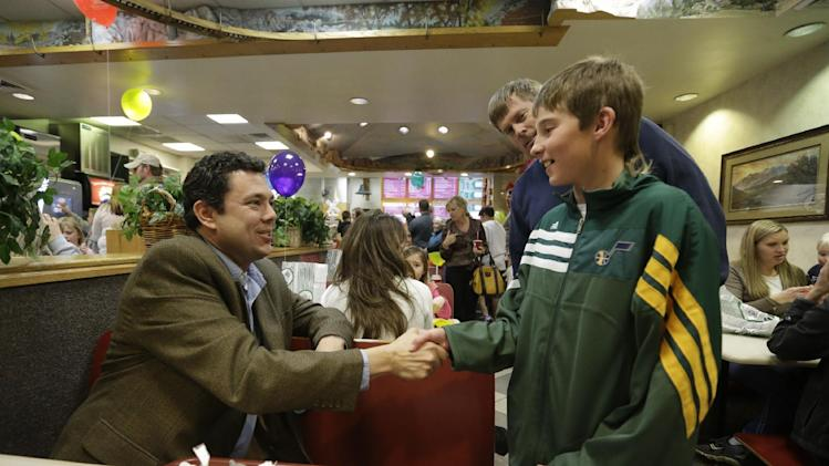 In this Feb. 7, 2013 photo, Rep. Jason Chaffetz, R-Utah, shakes hands with Jaxon Bridge, 12, at the Dairy Keen restaurant before attending a town hall meeting in Heber City, Utah. Chaffetz flew home from Washington last week to attend the town hall meeting. Many voters here and in similar communities elsewhere still want to do whatever it takes to stop President Barack Obama, and the politicians they elect are listening. (AP Photo/Rick Bowmer)