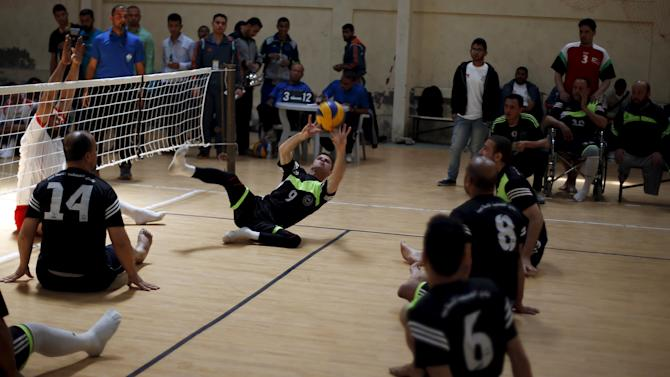 Disabled Palestinians take part in a local sitting volleyball championship in Gaza City