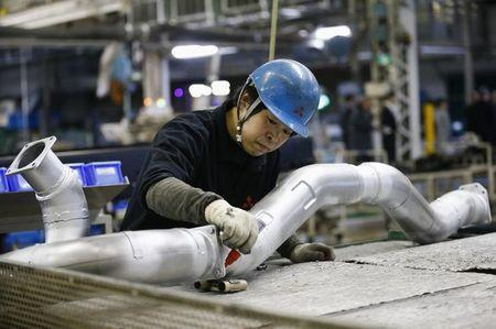 Japanese factory output seen falling in February, but outlook solid