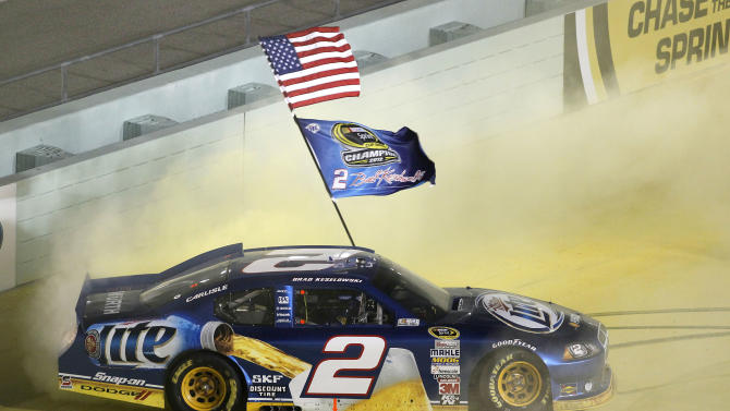 Brad Keselowski celebrates after winning the NASCAR Sprint Cup Series championship following an auto race at Homestead-Miami Speedway, Sunday, Nov. 18, 2012, in Homestead, Fla. Keselowski clinched the title after fellow title contender Jimmie Johnson pulled out of the season finale because of a parts failure. Jeff Gordon won the race. (AP Photo/Wilfredo Lee)