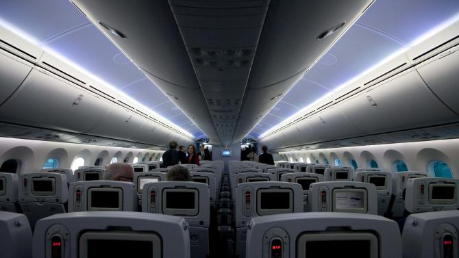 News media tour the inside of the second Boeing Co. 787 to be delivered to All Nippon Airways (ANA) at the assembly plant in Everett, Wash. on Sunday, Sept. 25, 2011. ANA is the first customer to take delivery of the 787. (AP Photo/John Froschauer)